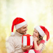 Smiling father giving daughter gift box — Stock Photo #35941255