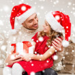 Smiling father and daughter holding gift box — Foto Stock