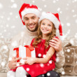 Smiling father and daughter holding gift box — Stock Photo #35941485