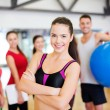 Woman standing in front of the group in gym — Foto Stock