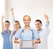 Smiling female doctor or nurse with tablet pc — Foto Stock