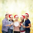 Stock Photo: Group of smiling students with clock showing 12