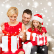 Happy family opening gift boxes — Stock Photo #36064181