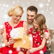 Happy family opening gift box — Foto Stock #36064257