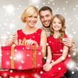 Happy family opening gift box — Stock Photo #36064303