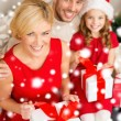 Happy family opening gift boxes — Stock Photo #36064887
