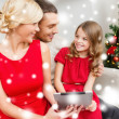 Smiling family with tablet pc — Stock Photo #36065031