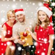 Smiling family decorating christmas tree — Stock Photo #36065415