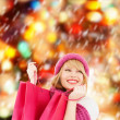 Woman in pink hat and scarf with shopping bags — Foto Stock