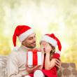 Smiling daughter waiting for a present from father — Stockfoto