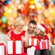 Happy family opening gift boxes — Stock Photo #36115801