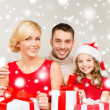 Smiling family holding many gift boxes — Stock Photo #36115837