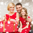 Happy family opening gift box — Stock Photo #36115935