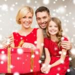 Happy family opening gift box — Stock Photo