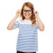 Smiling cute little girl with black eyeglasses — Stock Photo #36118709