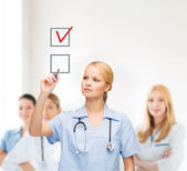 Doctor or nurse drawning checkmark into checkbox — Stock fotografie
