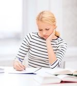 Concentrated woman studying in college — Stock Photo