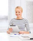 Student with tablet pc computer and notebook — Stock Photo