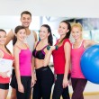 Group of smiling people in the gym — Stock Photo