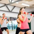 Group of smiling people working out with dumbbells — 图库照片 #36121949