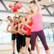 Group of smiling people working out with ball — Stock Photo