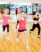 Group of concentrated people exercising in the gym — Stock Photo