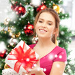 Happy woman with gift boxes and christmas tree — Foto Stock