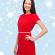 Smiling young woman in red dress — Stock Photo #36195387