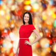 Smiling young woman in red dress — Stock Photo