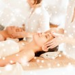 Couple getting facial massage in spa — Stock Photo #36196043