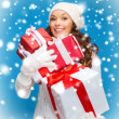 Woman in sweater and hat with many gift boxes — Stok fotoğraf