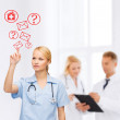 Focused doctor or nurse pointing to red envelope — Stock Photo
