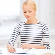 Concentrated woman studying in college — Stock Photo #36199145