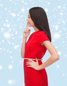 Young woman in red dress choosing — Stock Photo