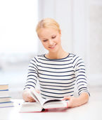 Smiling woman studying in college — Stock Photo
