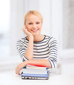 Smiling student with laptop, books and notebooks — Stock fotografie