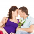 Happy expecting parents at home — Stockfoto