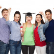 Group of standing smiling students with diploma — Photo