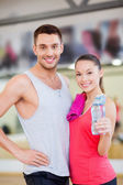 Two smiling people in the gym after class — Stock Photo