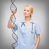 Focused doctor or nurse drawing dna molecule — Stock Photo