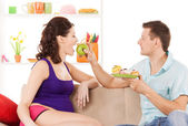 Happy expecting parents at home — Stock Photo