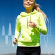 Stock Photo: Smiling womjogging outdoors