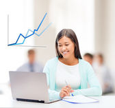 Asian businesswoman with laptop and documents — Stock Photo