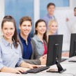 Students with computer monitor at school — Stock Photo #36661857