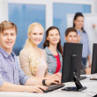 Students with computer monitor at school — Stockfoto