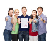 Group of students showing test and thumbs up — Stock Photo