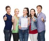Test olan ve başparmak öğrenci grubu — Stok fotoğraf