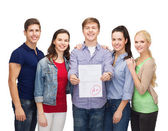 Group of students showing test result — Stock Photo