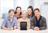 Smiling students with blank tablet pc screen — Zdjęcie stockowe