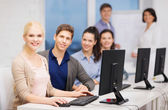 Students with computer monitor at school — Stock Photo